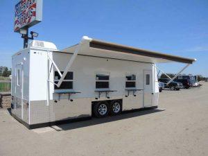 Ice castle fish house auction trailer